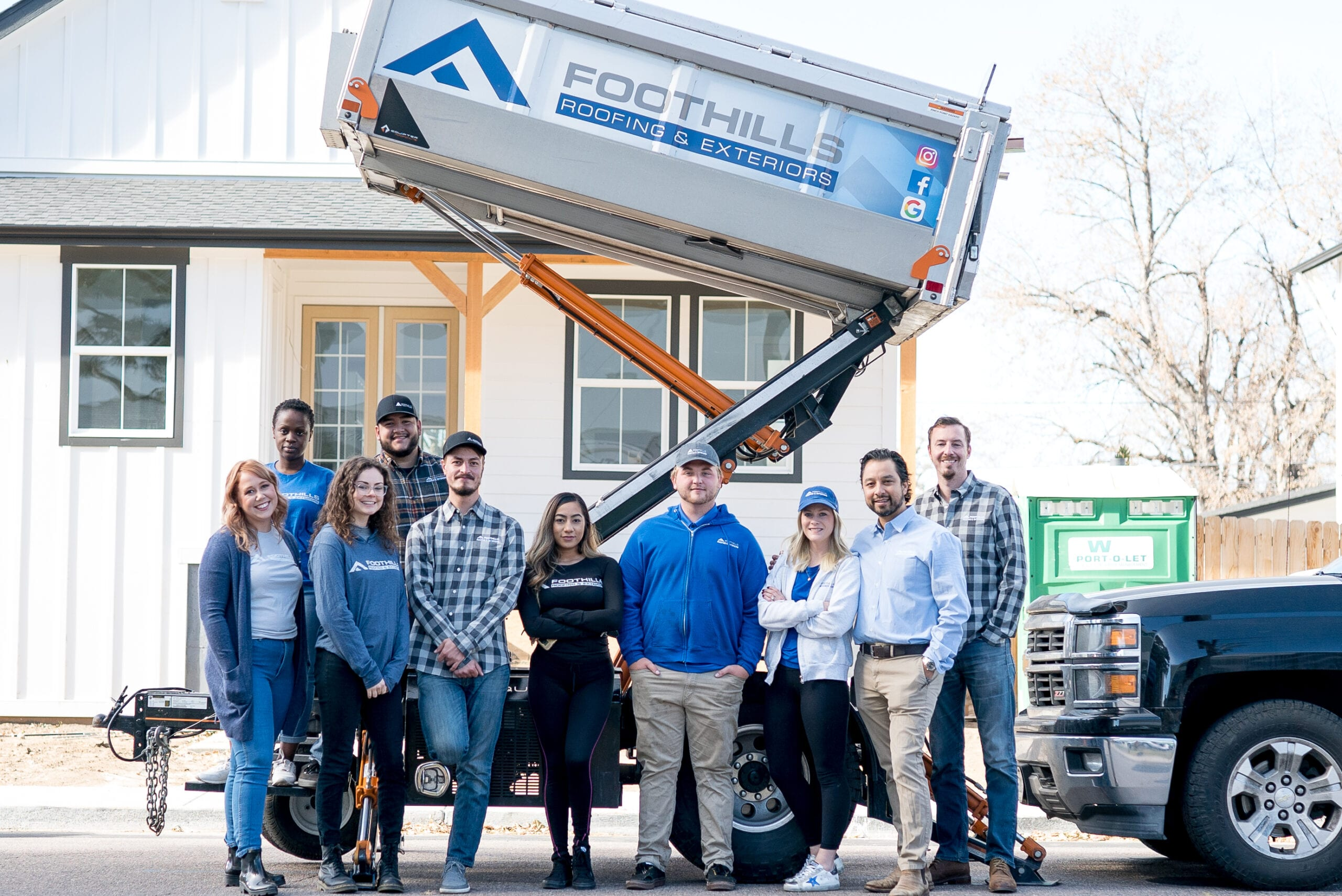 The Foothills Roofing & Exteriors Crew poses for a company photo.